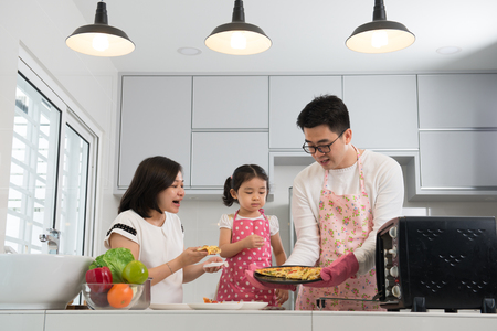 asian family baking at kitchen