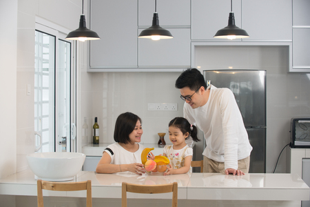 asian family cooking at kitchen