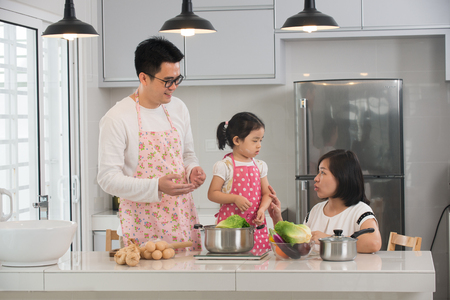 woman eat: asian family cooking at kitchen