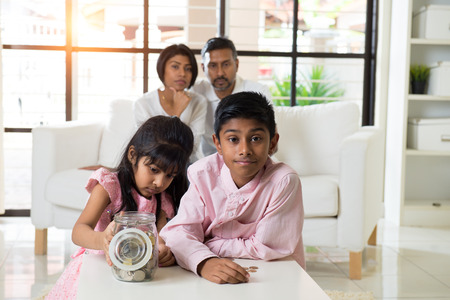 indian family teaching children on savings and financial planning photo