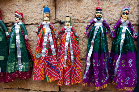Colorful handmade puppets on display for sale in Jaisalmer, Rajasthan.