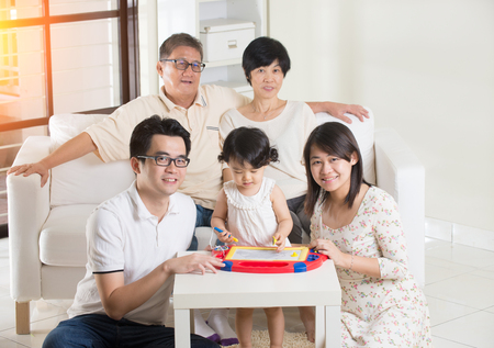 multi generation asian family at home photo