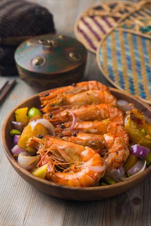 singaporean: chilli prawns in traditional setting