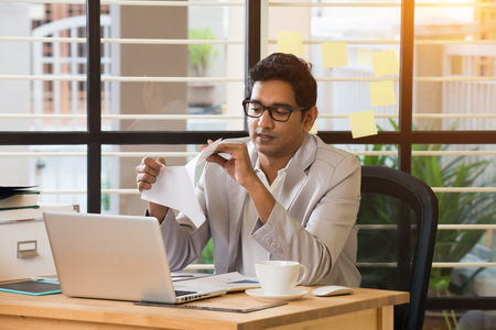 resignation: indian male typing resignation letter