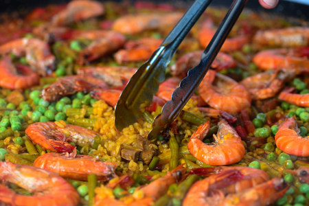 Paella with seafood and chicken. Prepared in wok. Stock Photo