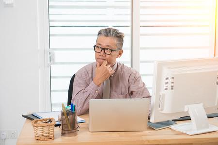 asian business senior male thinking Archivio Fotografico