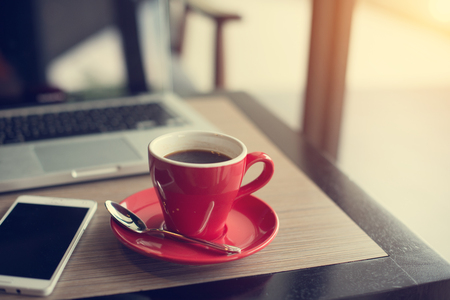 laptop and black coffe in vintage tone