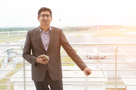 indian male walking at airport