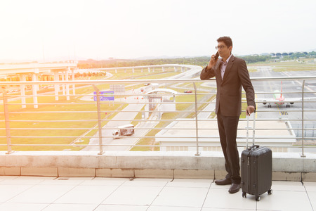 indian male walking at airport photo