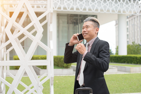 Senior Asian businessman on the phone