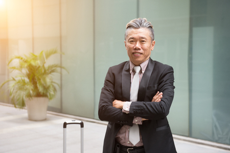 asian senior business man outdoor