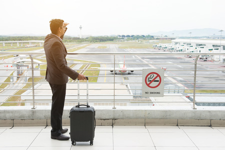 indian business male looking at flights photo