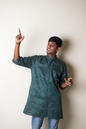 dhoti: traditional teenage indian male dancing