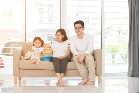 asian family on sofa photo