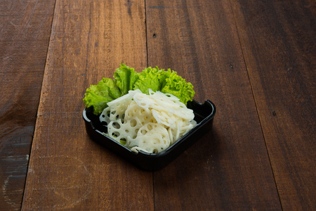raw sliced lotus root Stock Photo