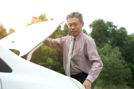 asian senior male with broken car Stock Photo