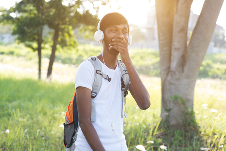 indian teenage male outdoor listening to music