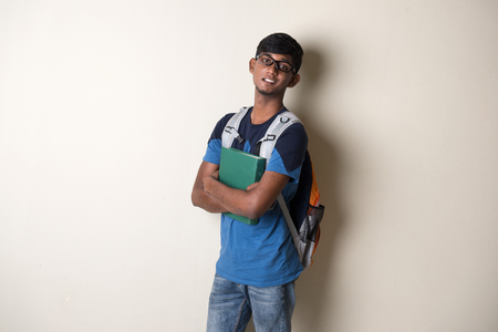 indian teenage male holding a book Stock Photo