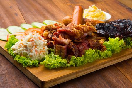 roasted pork knuckle ribs ,sausage and mash potatoes