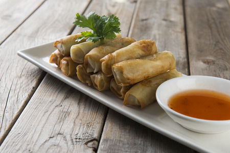 Lumpia Spring Rolls on Wooden Table in Restaurant