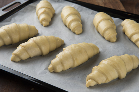 Raw croissants prepared for baking