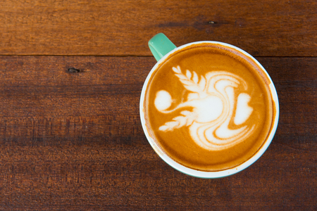 latte coffe art with wooden background