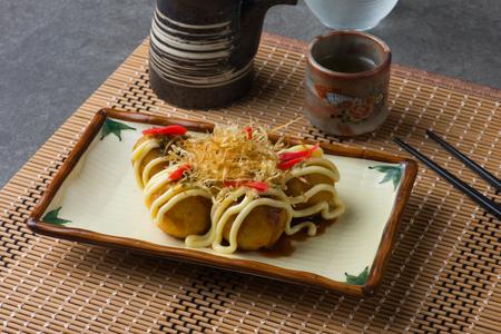 Takoyaki fried battered octopus balls traditional japanese cuisine Stock Photo