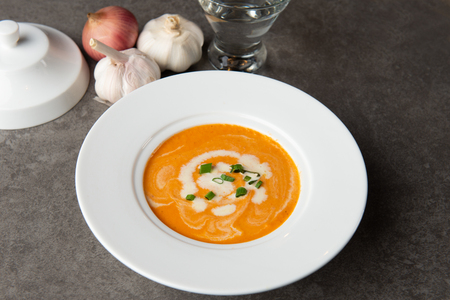 pumpkin soup with spices on table Stock Photo