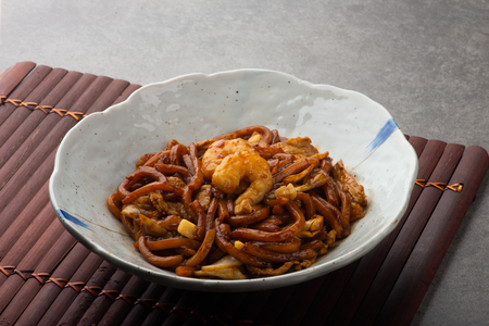 malaysian famous hokkien noodles with background Stock Photo