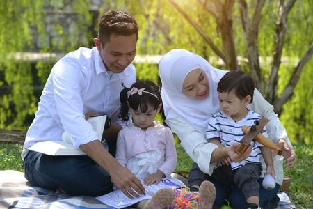 malay family reading outdoor Stock Photo