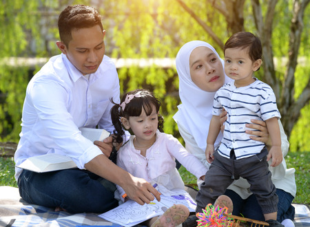 malay family enjoying quality time at the park Stock Photo