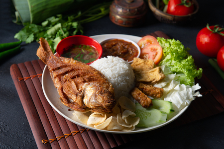 Traditional malay indonesian tilapia fish rice