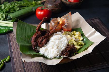 Nasi lemak kukus with quail meat top view, Malaysian local food