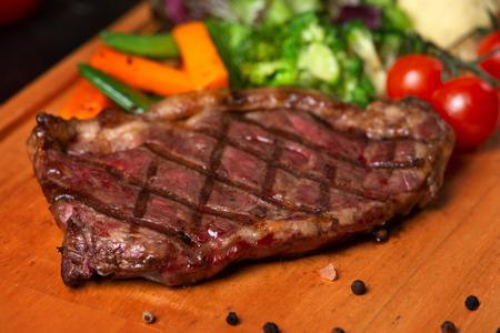 Sirloin steak on wood Stock Photo