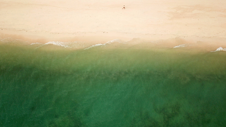 Drone view of beautiful beach. Aerial drone shot of turquoise sea water at the beach
