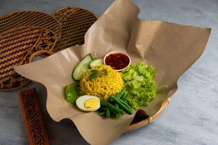 malaysian style turmeric rice in traditional settings Stock Photo