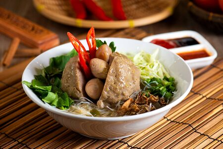 Indonesian meatball served with soup and noodle
