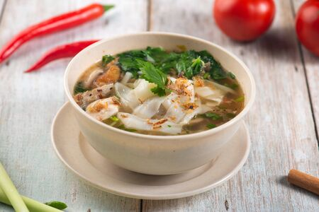 keow teow sup or ladna flat noodles soup in traditional malay style
