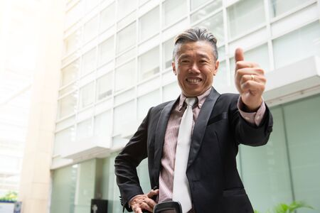 Portrait of smiling chinese businessman looking at camera positively 免版税图像