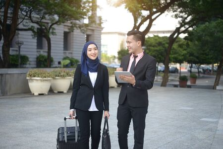 malay business team travelling with outdoor background