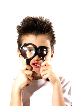 distorted image: Boy looking through a two magnifying glasses, lens