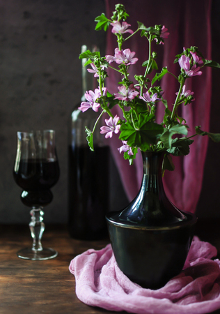 A glass of red wine - a refined bouquet of flavor and taste, a sense of celebration. Stock Photo