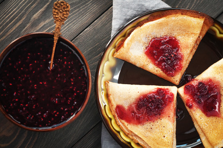 Delicious pancakes with sweet fillings. Maslenitsa. Stock Photo