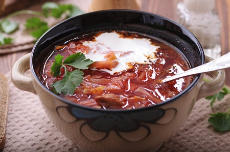 Delicious vegetable soup from cabbage and beet. Borscht.
