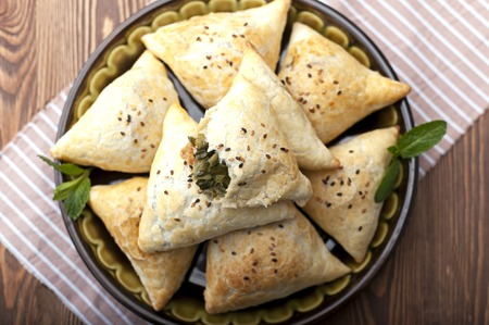The national dish of Uzbekistan is samsa with greens. Tasty, healthy, spring dish. Stock Photo