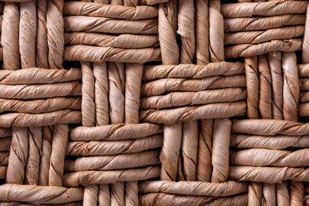 Weaving from dried vegetable fiber. Beautiful texture. Basket weaving. Beautiful, woven pattern of vegetable fiber.