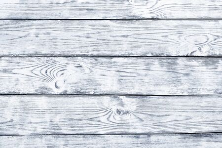 Background with unevenly applied paint, old and worn with a well-defined wood texture. Interesting texture of the wooden background. Background with a pronounced wood texture, painted white  Foto de archivo