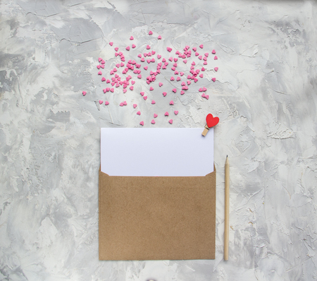 Letter with red and pink hearts on white gray background. Valentine day minimal concept Flat Lay Top View Copy Space