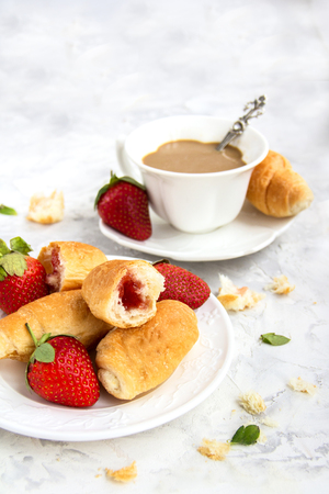 French Breakfast Dessert Croissants Fresh Strawberry with a Cup of coffee On a white Background Copy Space Beautiful table Setting Mother's day ,Valentine's Day
