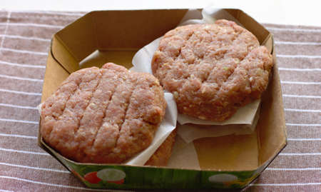 Plant based meat concept. Vegetable burger patties in carton tray. First non-soy plant meat to sell in supermarkets.